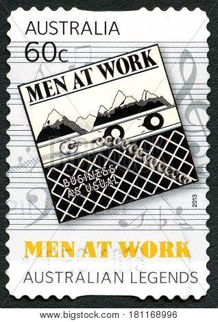 AUSTRALIA - CIRCA 2013: A used postage stamp from Australia celebrating Australian legendary Rock band Men at Work circa 2013.