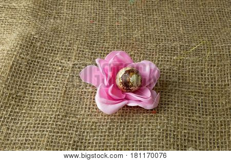 quail egg in the shape of a flower to the Easter holiday to paint with pink petals