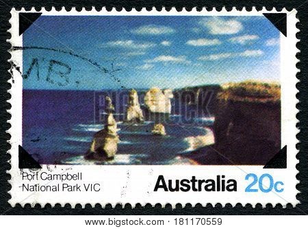 AUSTRALIA - CIRCA 1980: A used postage stamp from Australia depicting an image of Port Campbell National Park in Victoria Australia circa 1980.