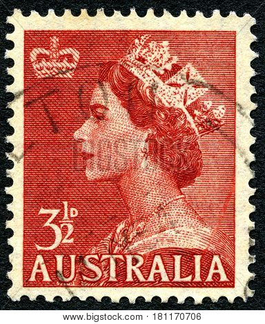 AUSTRALIA - CIRCA 1956: A used postage stamp from Australia depicting a portrait of Queen Elizabeth II circa 1956.