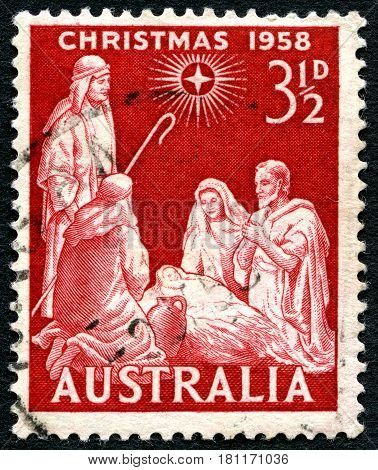 AUSTRALIA - CIRCA 1958: A used postage stamp from Australia depicting a festive biblical scene for Christmas circa 1958.