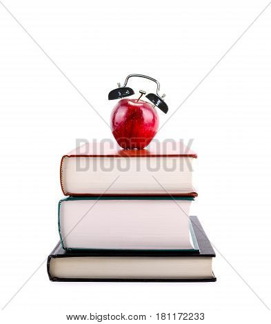 Back To School: Apple Alarm Clock On Stack Of Books