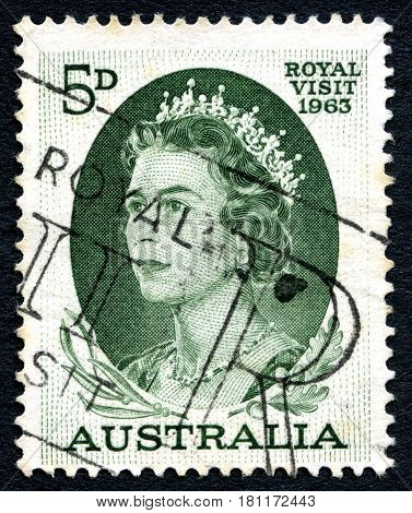 AUSTRALIA - CIRCA 1963: A used postage stamp from Australia depicting a portrait of Queen Elizabeth II commemorating the 1963 Royal Visit to Australia circa 1963.
