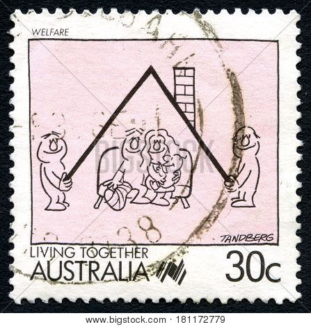 AUSTRALIA - CIRCA 1988: A used postage stamp from Australia depicting an illustration which symbolises Welfare and Living Together circa 1988.