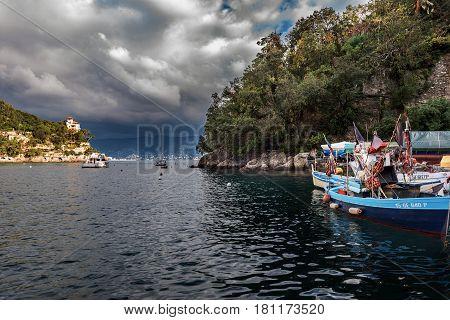 PORTOFINO, ITALY - DECEMBER 2016: Sea bay with fishing boats at Portofino town, Italy