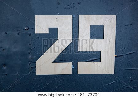Large wooden digits on the blue front door