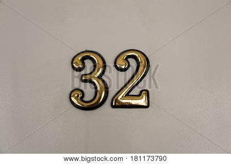 Large gold-plated digits on a gray surface