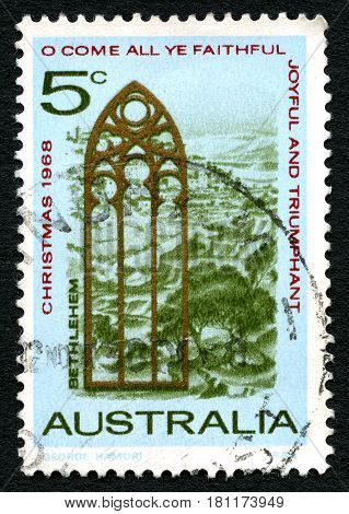 AUSTRALIA - CIRCA 1968: A used postage stamp from Australia depicting a festive illustration and message to celebrate Christmas circa 1968.