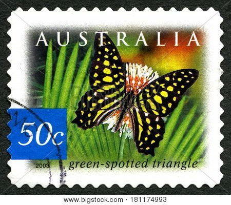 AUSTRALIA - CIRCA 2003: A used postage stamp from Australia depicting an illustration of a Green Spotted Triangle Butterfly circa 2003.