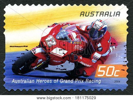 AUSTRALIA - CIRCA 2004: A used postage stamp from Australia celebrating Australian Heroes of Grand Prix Racing with an image of Troy Bayliss circa 2004.