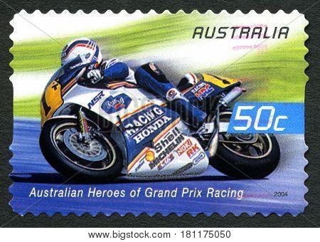 AUSTRALIA - CIRCA 2004: A used postage stamp from Australia celebrating Australian Heroes of Grand Prix Racing with an image of Wayne Gardner circa 2004.