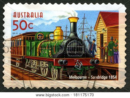 AUSTRALIA - CIRCA 2004: A used postage stamp from Australia depicting an illustration of an early Steam Engine passenger train that ran between Melbourne and Sandridge circa 2004.