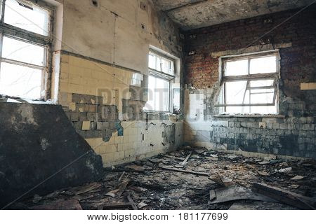 Old abandoned production building, interior inside, peeling walls and broken windows