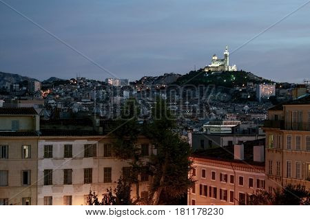 Typical view of Notre Dame de la Garde basilica in Marseille France from Saint Charles district at dusk