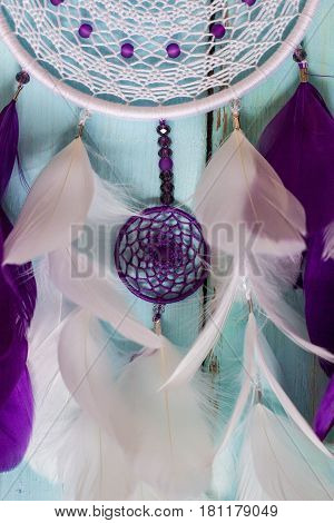 Colorful Dreamcatcher made of feathers leather beads and ropes hanging handmade