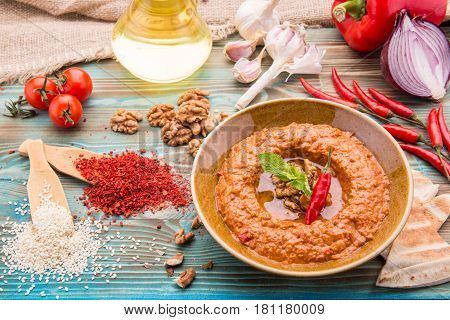 Traditional hot pepper, tomato paste, walnut, sesame paste, onions and garlic dish