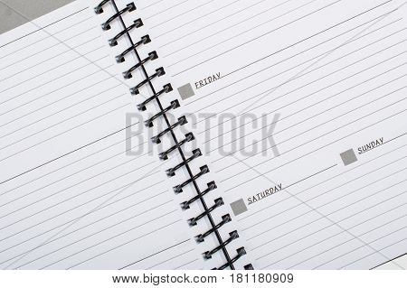 Spiral bound journal with days and lines.