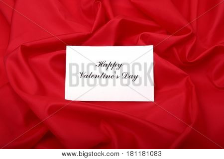 blank greetings card on a red background. Left empty for the designer to add their own message