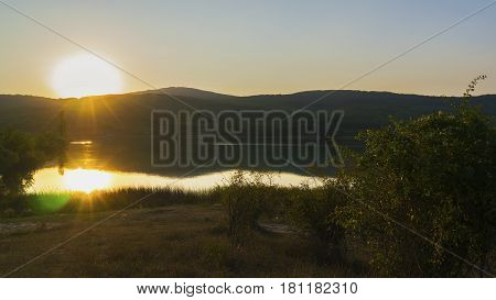 The beautiful sunset over the lake in the mountains