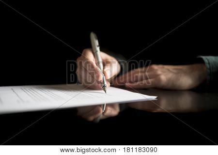 Low View Of Businessman Hand Signing Legal Or Insurance Document