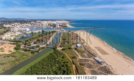Aerial view of Vilamoura with coastline and docks, Algarve, Portugal,