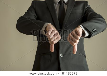 Businessman Giving Thumbs Down Sign