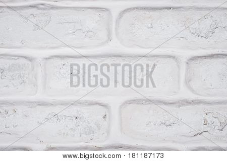 Abstract horizontal white background of a shabby brick wall.