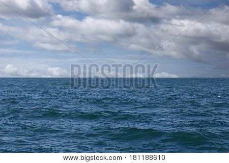 Sea wave and blue sky background in tropical ocean summer.