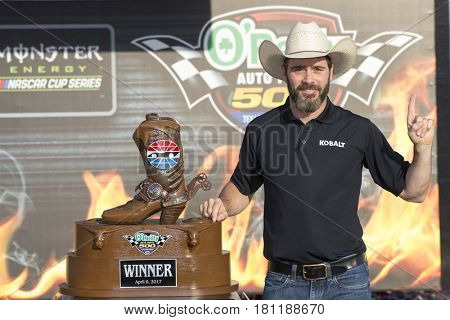 April 09, 2017 - Ft. Worth, Texas, USA: Jimmie Johnson (48) poses with his trophy after winning the O'Reilly Auto Parts 500 at Texas Motor Speedway in Ft. Worth, Texas.
