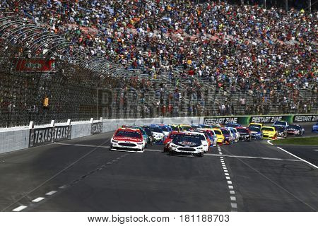 April 09, 2017 - Ft. Worth, Texas, USA: Ryan Blaney (21) and Kevin Harvick (4) lead the field to the start of the O'Reilly Auto Parts 500 at Texas Motor Speedway in Ft. Worth, Texas.