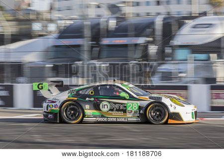 April 07, 2017 - Long Beach, California, USA:  The Alegra Motorsports Porsche 911 GT3-R races through the turns at the Bubba Burger Sports Car Grand Prix At Long Beach in Long Beach, California.