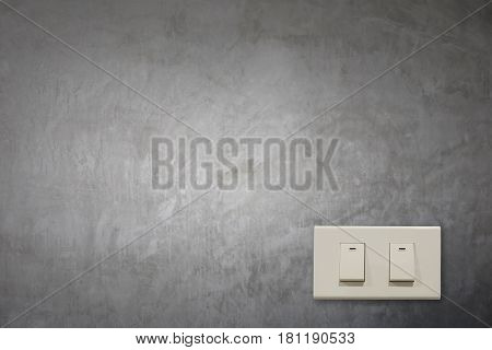 White electric switch on cement wall and have copy space to input your text.