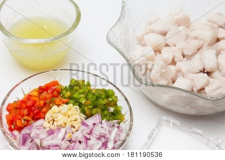 Peruvian ceviche preparation : Blanched fish, lemon juice and chopped vegetables