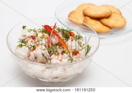 Peruvian ceviche preparation : White fish Peruvian ceviche served in a transparent bowl with crackers