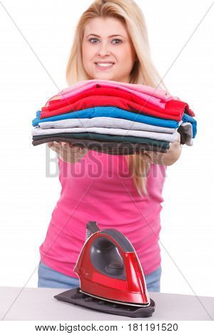 Woman Holding Folded Clothes After Ironing