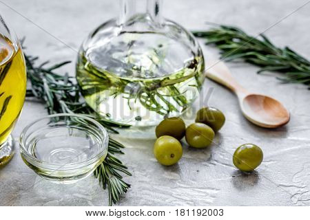 organic olive oil with fresh ingredients on stone kitchen table background