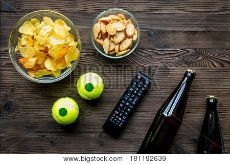 snacks for watching sport match with balls and beer on wooden desk background top view mock-up