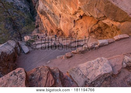 Hikers Climb Walters Wiggles As Early Morning LIght Hits on their way to Angel's Landing
