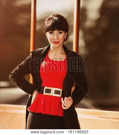 Beautiful brunette woman in stylish outfit on street