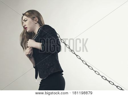 Young angrywoman holding metal chain isolated photo