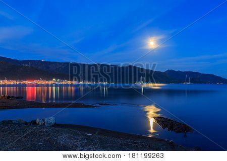 Marmaris lights with moon on the beach