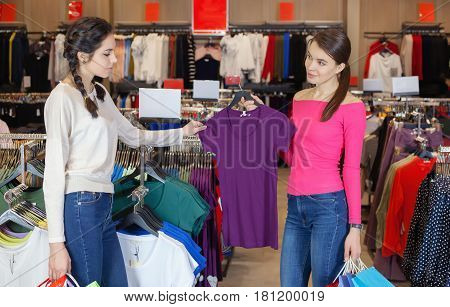 Two Young Girl Walks In The Mall With Gift Bags