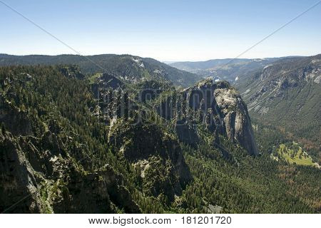 Views Of Trees, Cliffs, And Mountains In Yosemite National Park