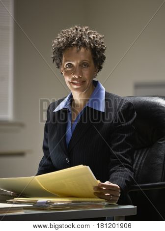 African businesswoman holding paperwork
