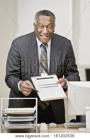 African businessman holding clipboard