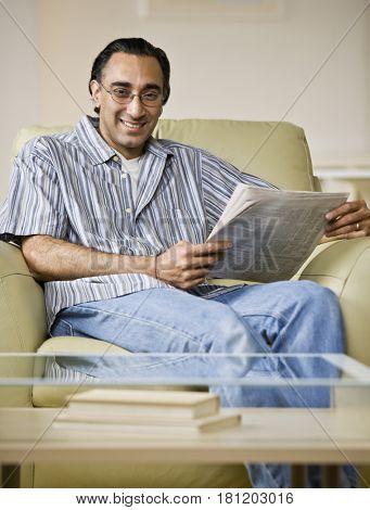 Indian man holding newspaper