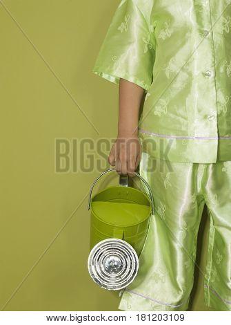 Eurasian girl holding watering can