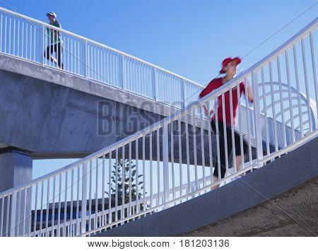 Multi-ethnic women running on elevated walkways