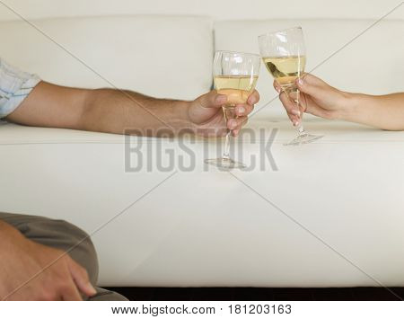 Multi-ethnic couple toasting with wine