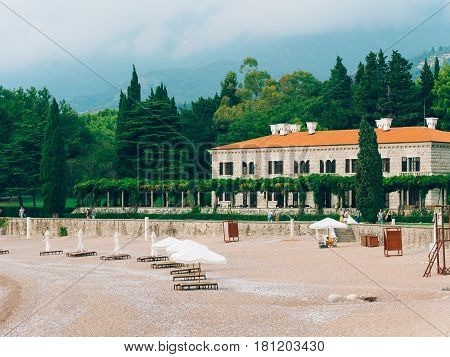 The Villa Milocer is one of the most beautiful resorts of the Budva riviera surrounded by the shady park, with the famous Queen's Beach on the foreground, Sveti Stefan, Montenegro.
